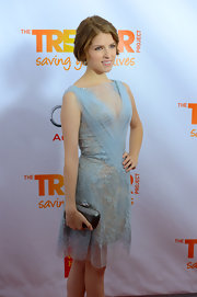 Anna Kendrick dazzled with this metallic silver clutch and beaded dress combo during Trevor Live.