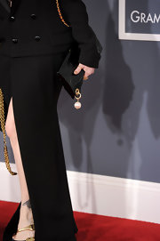 Cyndi Lauper carried a matching patent leather purse with a pearl charm at the Grammy Awards.