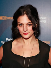 Jenny Slate sported red lipstick for a pop of color to her black outfit.