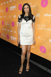 Famke Janssen showed some leg at the Tropfest New York 2012 wearing a chic white dress with applique black flowers.