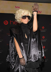 Lady Gaga styled her outfit with a pair of black lace gloves during her HMV in-store appearance.