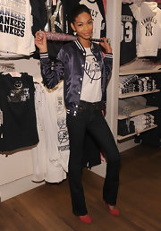 Chanel Iman went sporty in a purple varsity jacket for the VS Pink Major League Baseball collection launch.