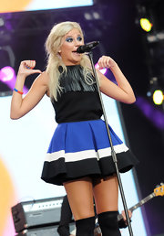Pixie Lott was edgy-cute in a fringed black top during the Heroes Concert.