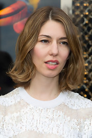 Sofia Coppola styled her hair with bouncy waves for the Louis Vuitton boutique opening.