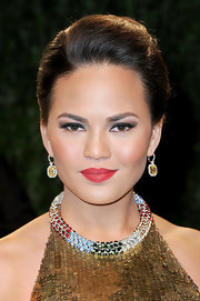 Chrissy Teigen chose a rich red lip color for a bold beauty look.