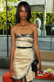 Liya Kebede teamed a black leather clutch with a gold strapless dress for the CFDA Fashion Awards.