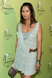Padma Lakshmi sported an edgy-chic silver cuff at the Perrier-Jouet celebration of Michael Kalish's Belle Epoque sculpture.