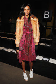 Liya Kebede kept it youthful in a pink and red print dress when she attended the Edun fashion show.