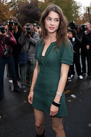 Astrid Berges Frisbey attended the Chanel fashion show wearing an elegant diamond watch.