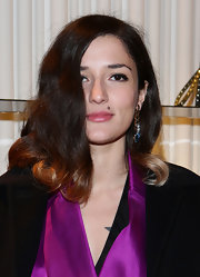 Eleonora Carisi styled her hair into a bouncy wavy 'do for the Valentino cocktail party.