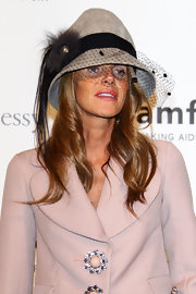 Anna dello Russo donned one of her classier hats for the amfAR Milano Gala: a fur and mesh number by Louis Vuitton.