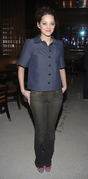 Marion Cotillard opted for a casual look with a pair of brown jeans when she attended the 'La Vie En Rose' reception.