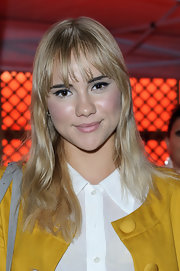 Suki Waterhouse wore her hair down with gentle waves and wispy bangs during the British Heart Foundation party.