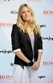 Sienna Miller styled her outfit with a thick black cuff bracelet for a Boss Orange fragrance promo event.