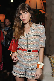 Lou Doillon piled on the colors with this Marni for H&M ensemble, consisting of a red belt and a patterned short suit, when she attended the collection's launch.