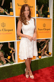 Minka Kelly attended the Veuve Clicquot Polo classic in Jersey City ins a white sundress with a decorative lace overlay.