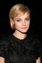 Pink lips and black-lined eyes topped off Jessica Stam's show-going look.