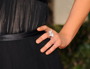 Mila Kunis showed off a diamond statement ring by Cartier at the 2012 Golden Globes.