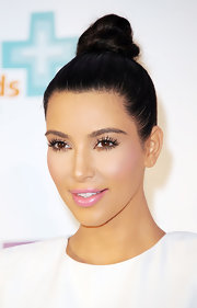 Kim Kardashian attended the QuickTrim photocall wearing her hair in a cute top knot.