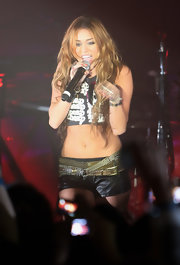Miley Cyrus sported skimpy leather short shorts paired with a crop-top during her 1515 Club concert.