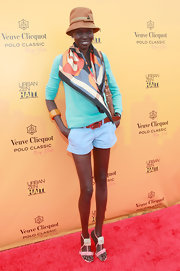 Alek Wek finished off her look in chic style with a pair of embellished pink sandals.