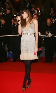 Lou Doillon complemented her dress with elegant gold peep-toe heels.