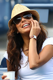 Eva Longoria accessorized with a stylish rectangle-faced watch by Hermes.