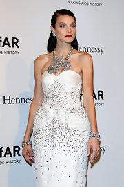 Jessica Stam paired a massive diamond statement necklace with a beaded dress for a bling-y look during the amfAR Milano Gala.