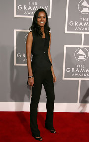 Liya Kebede kept it casual on the Grammys red carpet in a black vest layered over a tank top.