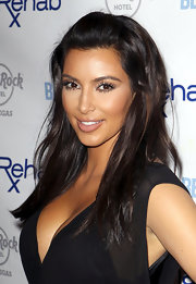 Kim Kardashian sported a breezy-chic half-up 'do at the Rehab Sundays Pool Party.