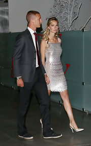 Beatrice Borromeo paired beige satin slingbacks with a paillette dress for Convivio 2010.