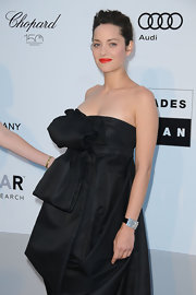 Marion Cotillard amped up the luxe factor with a diamond-studded watch by Chopard at the amfAR Gala.