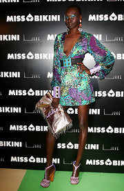 Alek Wek complemented her dress with a pair of chunky, studded T-strap pumps.