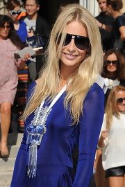 Poppy Delevingne attended the Dior fashion show looking sporty in her designer shield sunglasses.