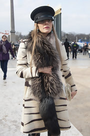 Hat lover Anna dello Russo made a safe and chic choice with this black captain's cap for the Valentino fashion show.