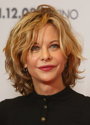 Meg Ryan was stylishly coiffed with this voluminous curly bob at the photocall for 'The Women.'