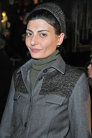 Giovanna Battaglia looked winter-ready at the Lanvin fashion show in a gray knit beanie that matched her jacket.