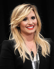 Demi Lovato finished off her look with an oversized pendant necklace by Charles Albert.