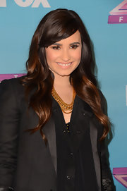 Demi Lovato brightened up her black outfit with a layered gold chain necklace by Karen London.