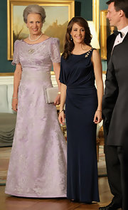 Princess Marie looked modern in an asymmetrical navy gown at the official for the Prince of Wales and Camilla.