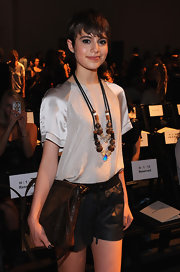 Sami Gayle added an exotic touch to her look with a pair of wooded beaded necklaces during the Rebecca Taylor fashion show.