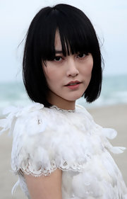 Rinko Kikuchi sported a bob with eye-skimming bangs at the Chanel Cruise 2010 show.