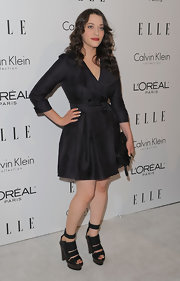 Kat Dennings teamed her LBD with a pair of chunky, strappy platform sandals.