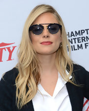 Dark shades with gold accents and top-bar detailing capped off Sienna Miller's look.