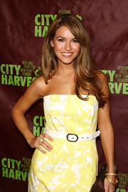 Chrishell Stause paired a white leather belt with a yellow print dress for the 2009 Summer in the City event.