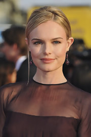 Kate Bosworth accessorized with a pair of gemstone drop earrings for a more glamorous finish to her simple hairstyle.