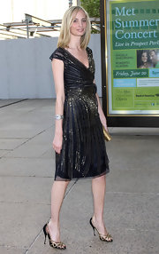 Lauren Santo Domingo looked flawless all the way down to her black and gold evening sandals.