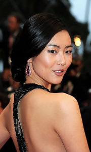 Liu Wen swept her hair back into a loose side chignon for the 'Amour' Cannes premiere.