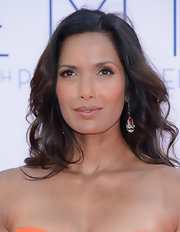 Padma Lakshmi complemented her 'do with a pair of coral, onyx, and diamond drop earrings by Fred Leighton.