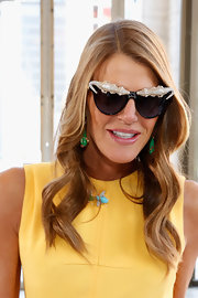 Anna dello Russo showed off a pair of crocodile-embellished cateye sunnies she designed for H&M.